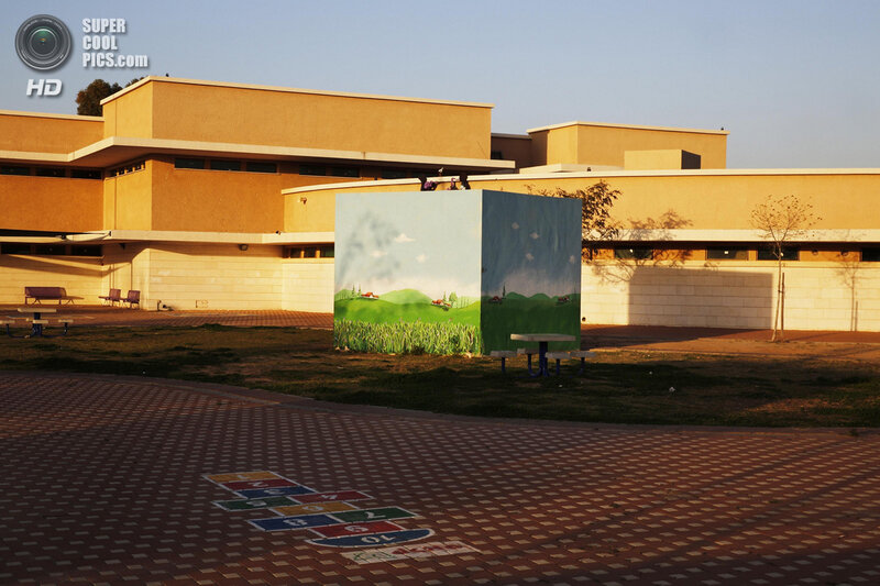 A decorated bomb shelter sits in a playground at a school built from reinforced concrete in the Israeli town of Sderot