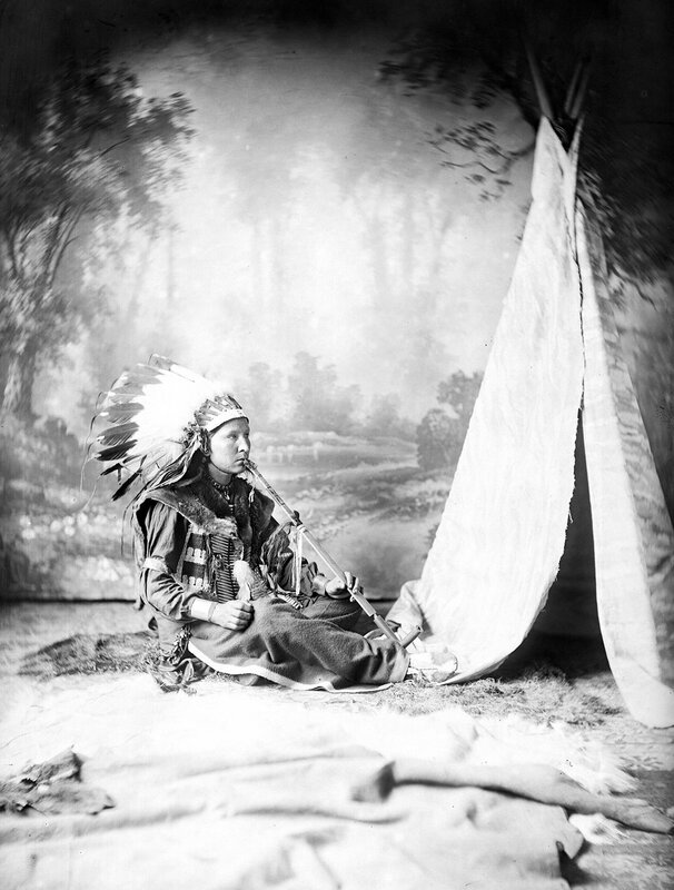 Unidentified Native American male, smoking pipe, 1880s