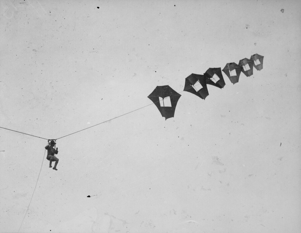 Lieutenant Kirk Booth of the U.S. Signal Corps being lifted skyward by the giant Perkins man-carrying kite at Camp Devens, Ayer, Massachusetts, ca. 1918