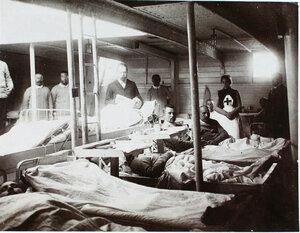 Младший врач А. А. Косминский (стоит в центре) у постели больного в палате № 1.
