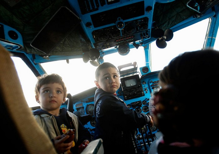 Children play in the cockpit of a plane at a kindergarten in the town of Rustavi