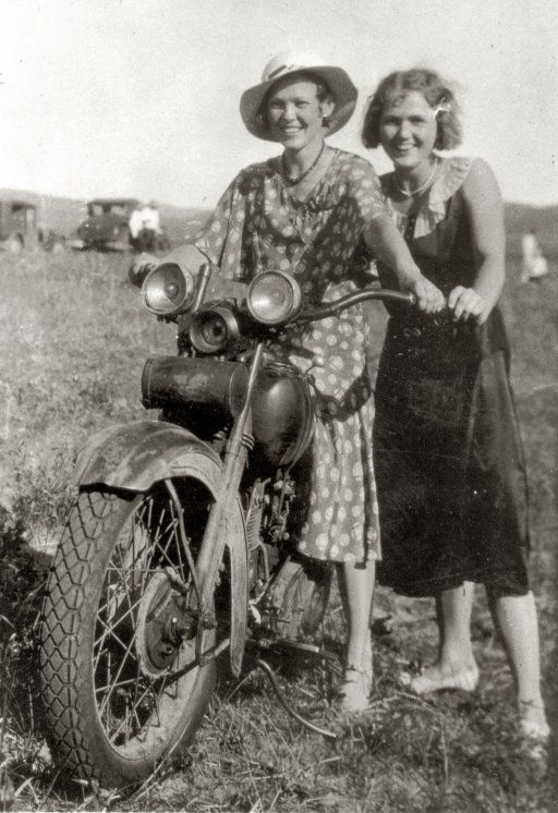 Two women riding a motorcycle in rural Nebraska between 1925 and 1935.jpg