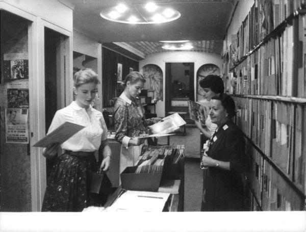 Ingrid Bergman looking at records.jpg