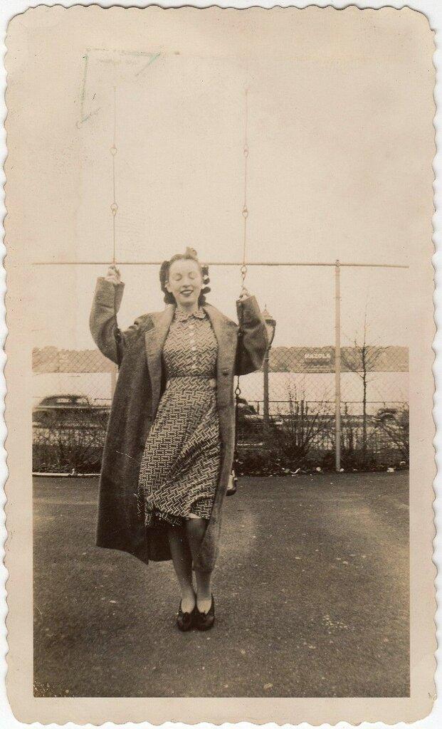 Girl on swing, c. 1940s.jpg