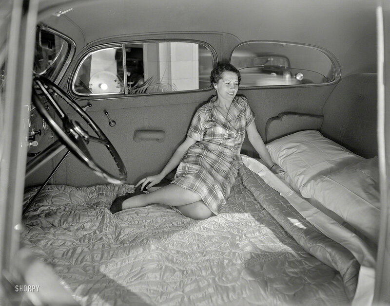 June 3, 1936. San Francisco. Woman in Pontiac made into bed