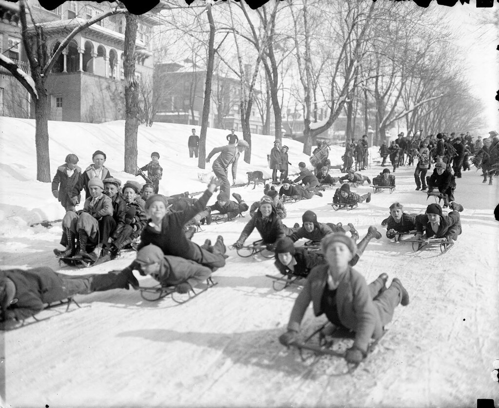 Sledding down Eighth Avenue near Grant Street in Denver, Colorado, between 1920 and 1930
