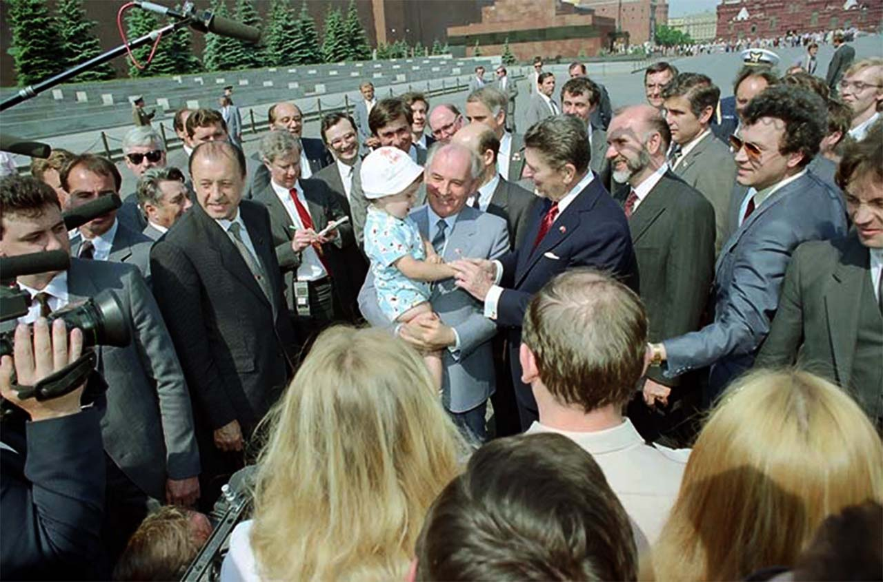 President Reagan and Soviet General Secretary Gorbachev greet a young child while touring Red Square during the Moscow Summit. 5_31_88(1280).jpg