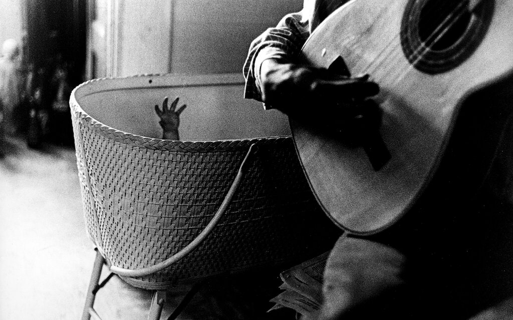 1960-61, Baby's hand with guitar.jpg