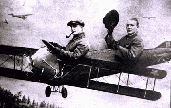 A grossly underappreciated and underseen photo of Mikhail Bulgakov (with opera and film director Leonid Batalov in the front seat), 1928.jpg