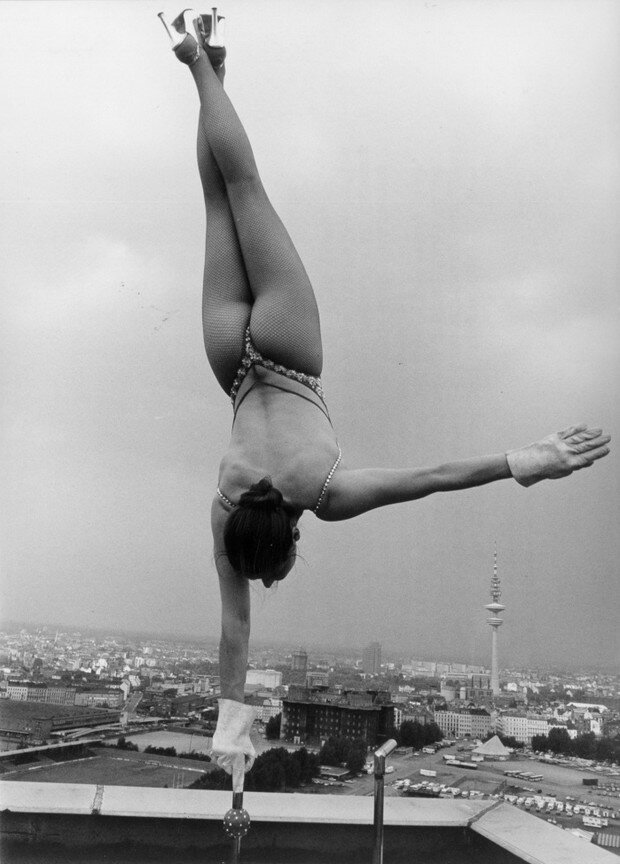 Circus performer Sylvia Teron performing her act on the roof of a skyscraper building in Hamburg, c1950.jpg