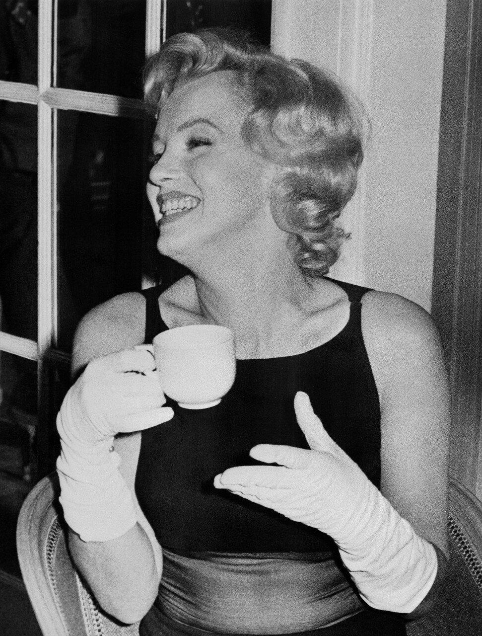 Marilyn Monroe Holding Tea Cup