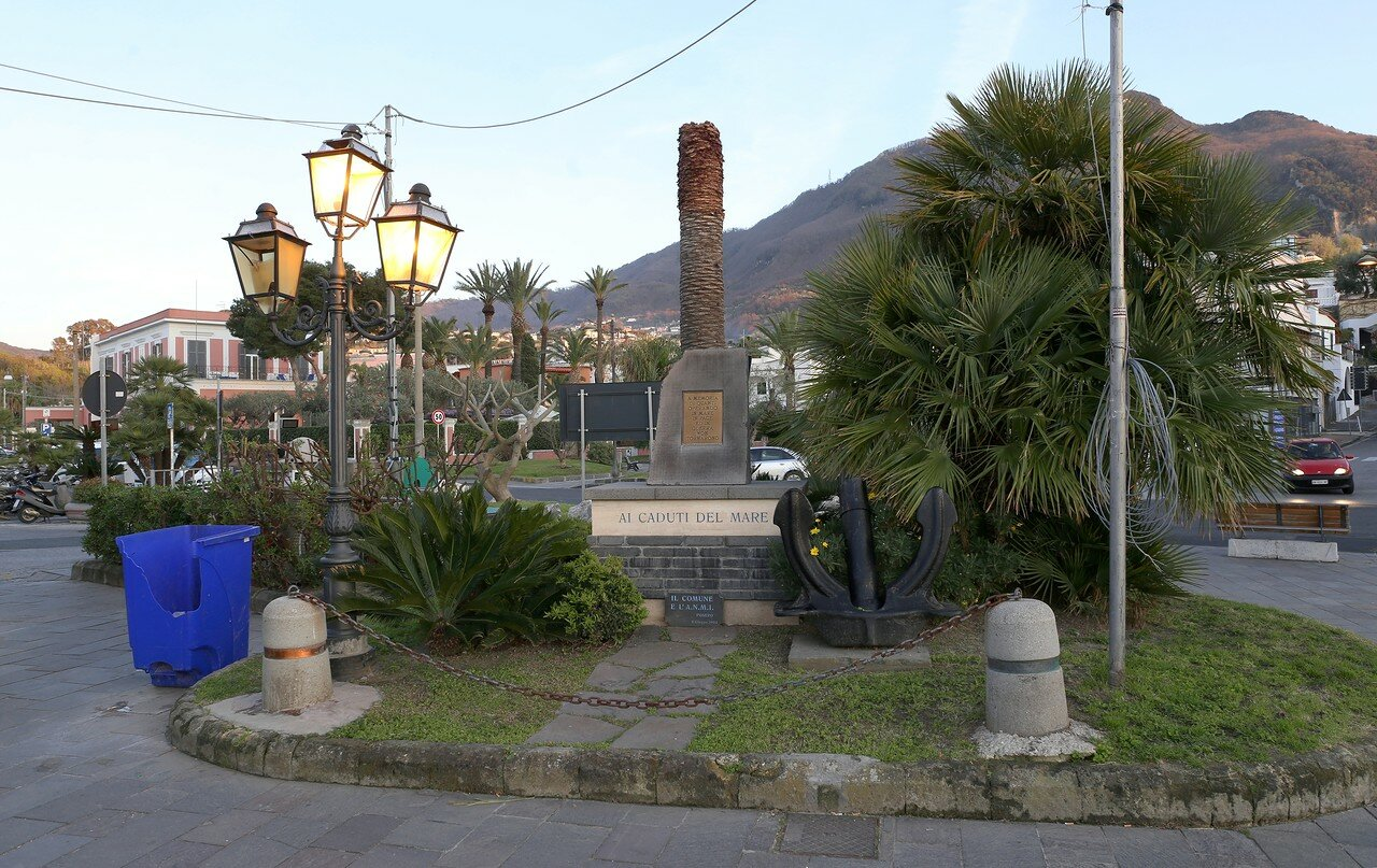 Ischia. Sunset in Lacco Ameno. Monument to the dead sailors.