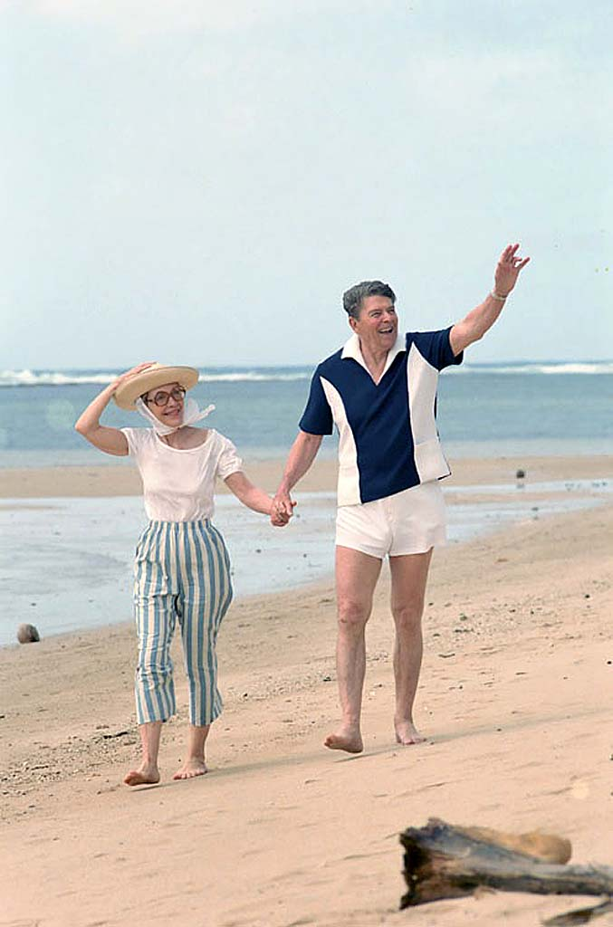President Reagan and Nancy Reagan walking along the beach in Kahala, Hawaii. 4_27_86