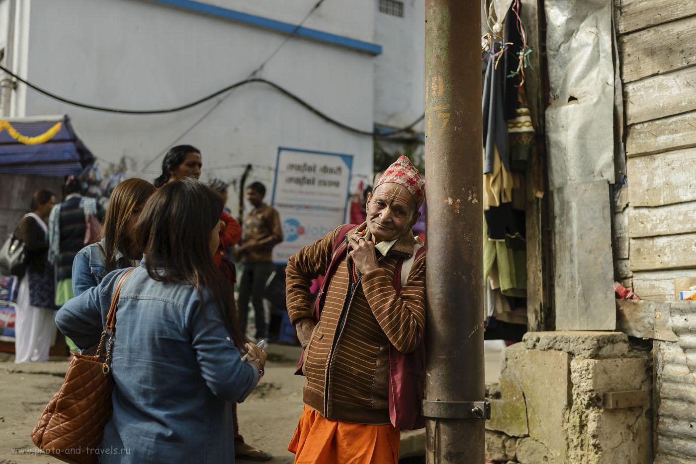 Фотография 25. В Гималаях люди выглядят не так, как на равнине. Здесь живут тибетцы. Уличный портрет в Дарджилинге. 1/1000, -0.67, 2.8, 250, 52.