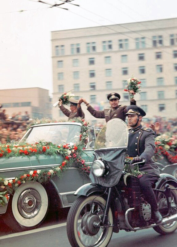 1962 Cosmonauts Andrian Nikolayev (left) and Pavel Popovich (right) driving through city streets..jpg