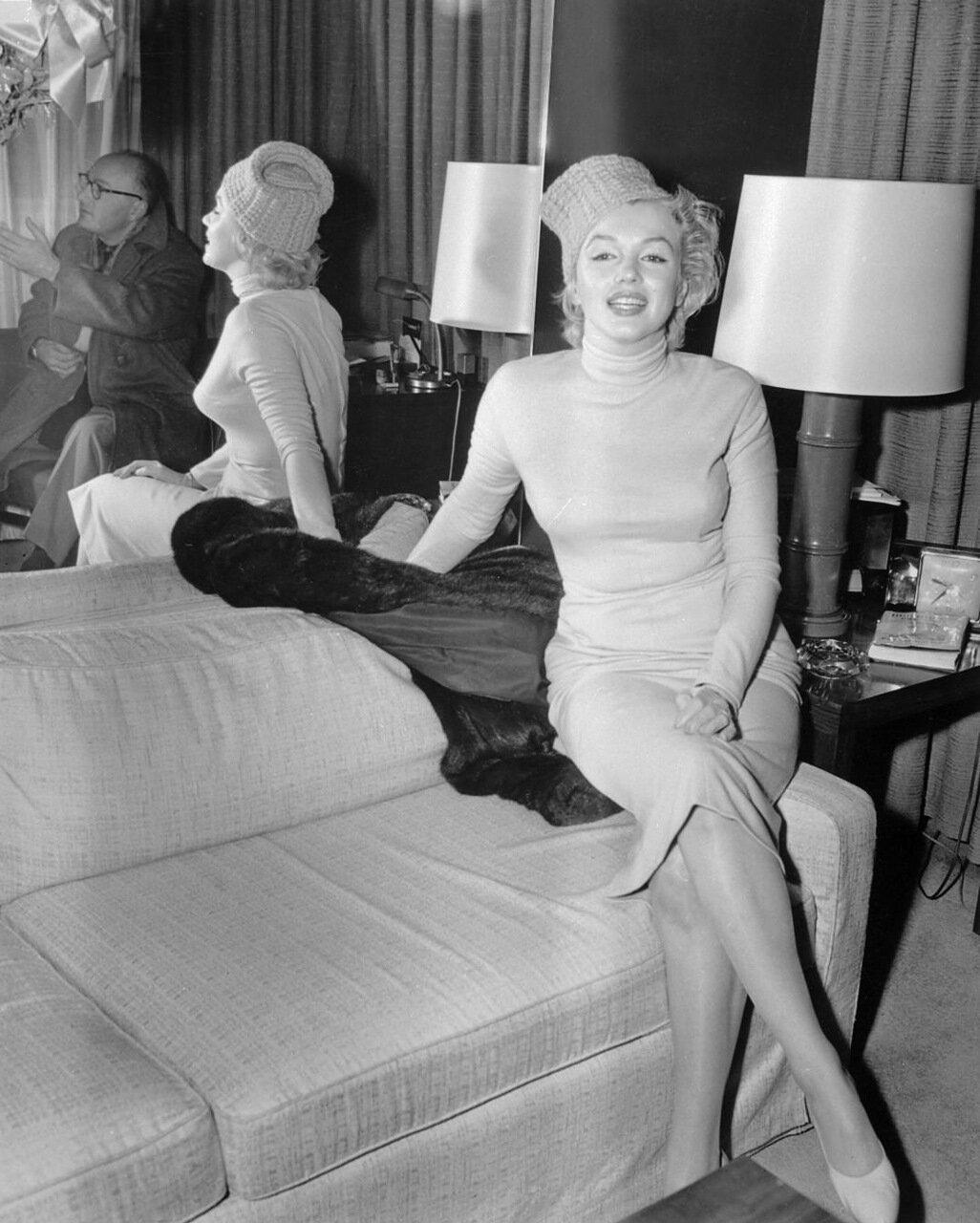 Marilyn Monroe Sitting on Arm of Sofa