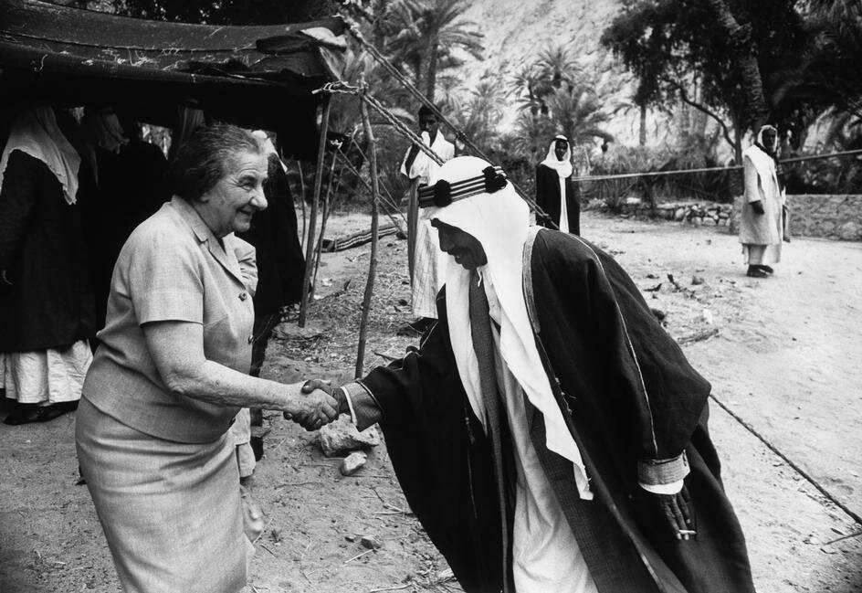 Israeli Prime Minister Golda MEIR being welcomed by Bedouin leaders in the Sinai. May 1970. photo Micha Bar-Am(1930-)