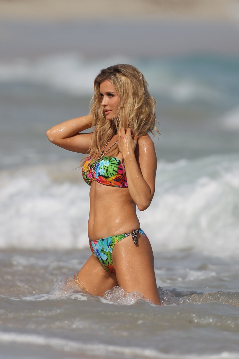 Joanna Krupa shows off her curves in her 2015 Esotiq swimwear line, during a photo shoot on the beach