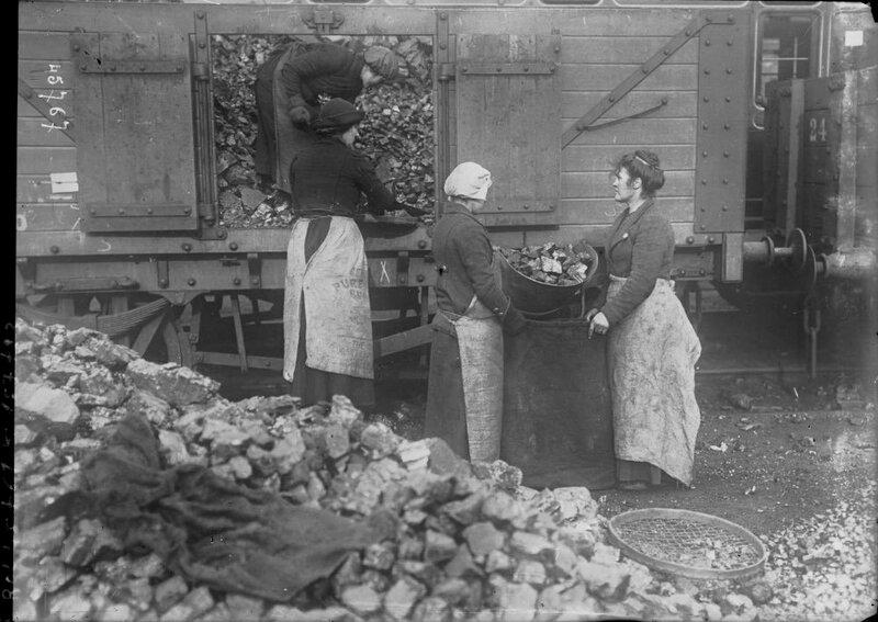Women unloading a coal wagon England