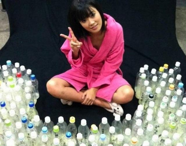 Японская звезда порно получила 100 бутылок спермы