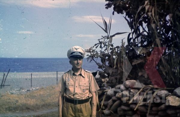 stock-photo-ww2-color-luftwaffe-field-division-2nd-lufllotte-sicily-1943-tropical-uniform-pilot-german-war-merit-cross-kvk-8479.jpg