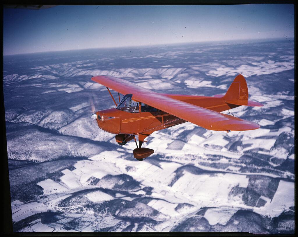 Piper J-4 Cub Coupe (rn NC26738) in flight