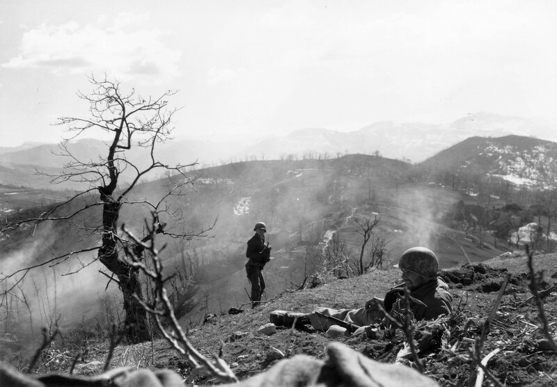 [1945] Members of the 10th Mountain Division are on a hill in the Apennine Range in Bologna Province, Italy