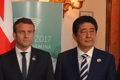 Абэ иМакрон оценили роль РФ в интернациональных отношениях