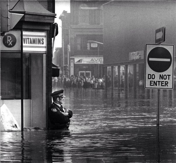 Const. John Shuttleworth wore waders as he stood waist-deep in Cambridge on May 17, 1974.jpg