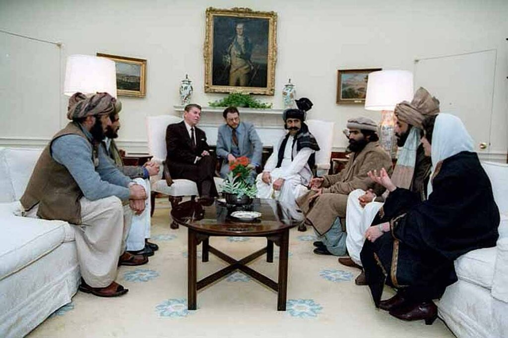 President Reagan meeting with Afghan Freedom Fighters to discuss Soviet atrocities in Afghanistan. 2/2/83.