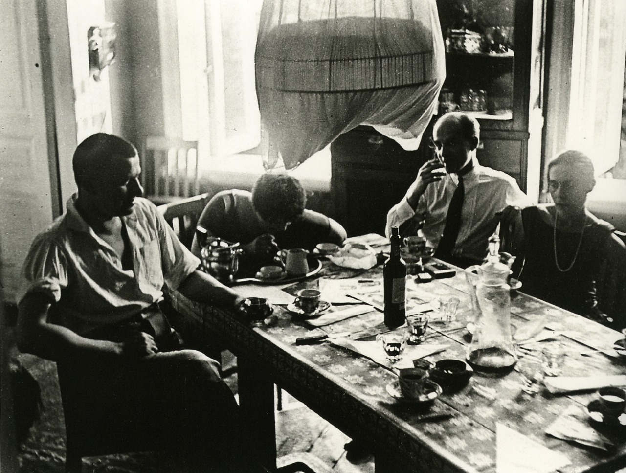 Vladimir Mayakovsky, Varvara Stepanova, art critic Osip Beskin and Lilya Brik in Briks' house on Gendrikov Street; photo by Alexander Rodchenko, 1928.jpg