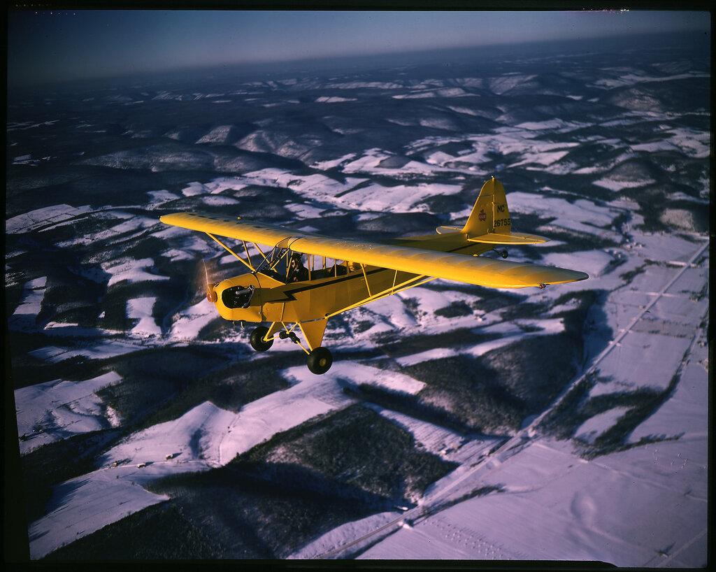 Piper J-3F Cub (rn NC26755) in flight