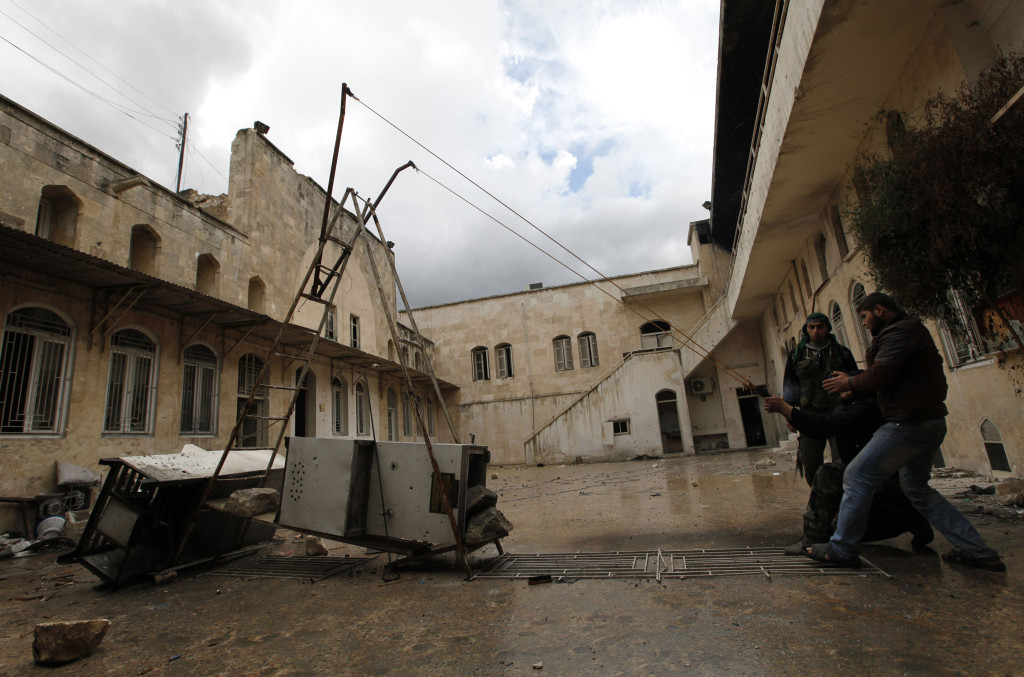 Free Syrian Army fighters use a homemade catapult in old Aleppo