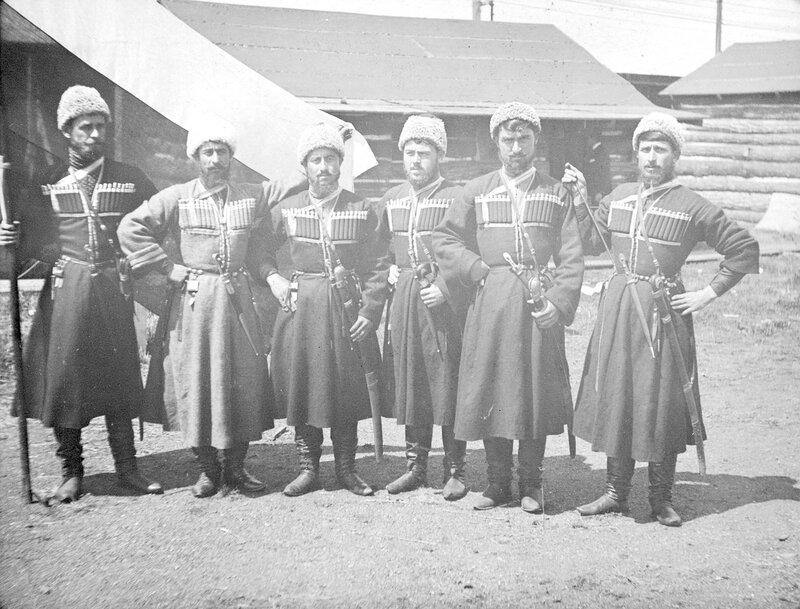 Six Russian Georgian Cossack men pose for a group portrait in Ambrose Park while touring with Buffalo Bill's Wild West Show, 1894