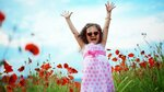 8531_happy-baby-girl-in-white-and-pink-dress-on-the-poppies-field.jpg