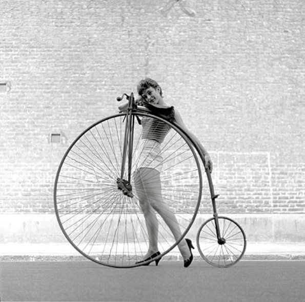 Frances Pidgeon models a bike, Ken Russell takes the photo, Penny Farthing on loan from The Troubador coffee house, London, 1956.jpg