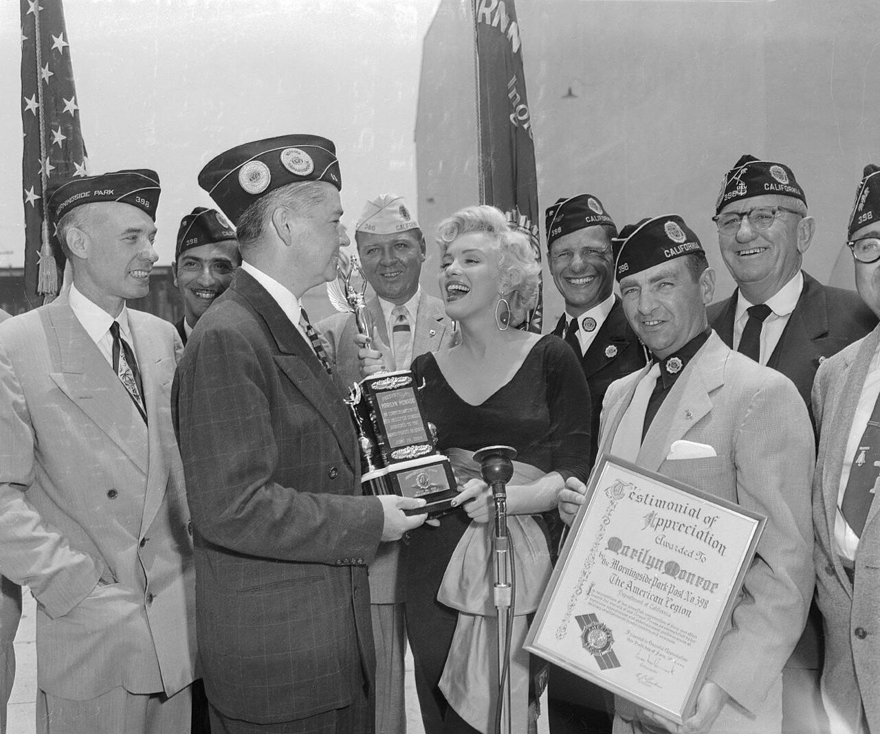 Marilyn Monroe Receiving a Trophy