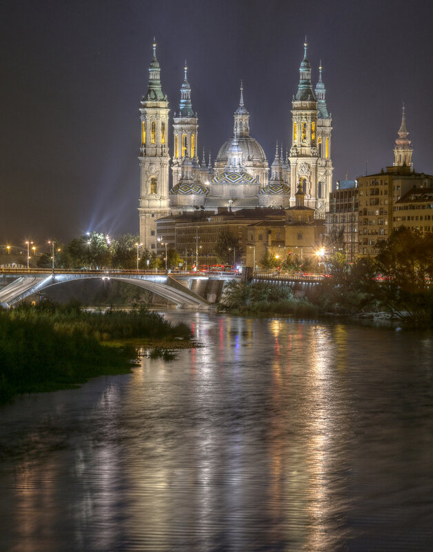 Zaragoza. The Cathedral of the virgin Pilar at night. View from the bridge of Almosara. HDR