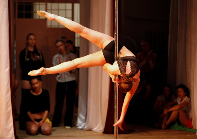 A participant performs during the Perfect Pole 2016 pole dance championship in the southern city of