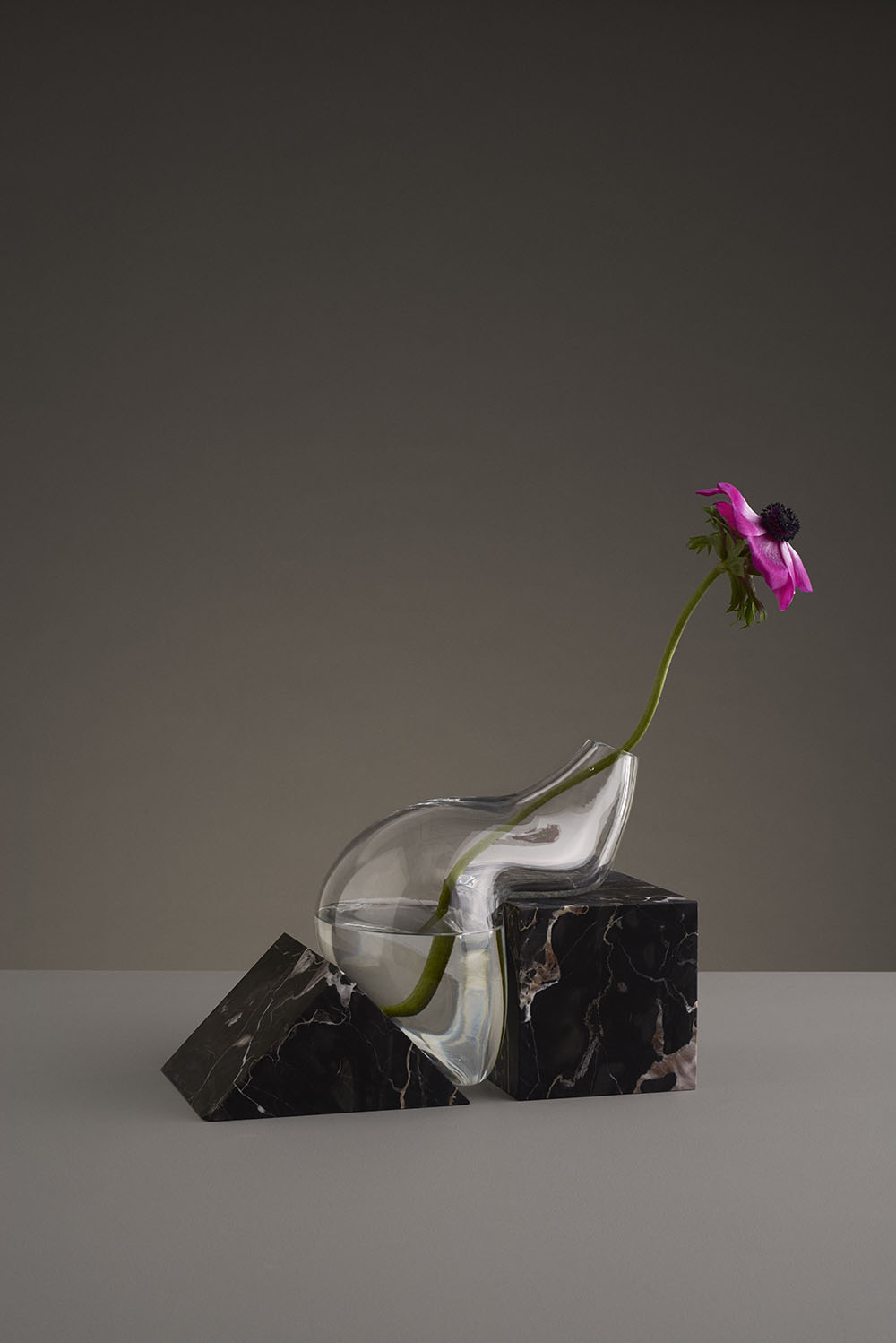 Misshapen Glass Vases by Studio E.O Appear to Melt Atop Angular Stone Platforms