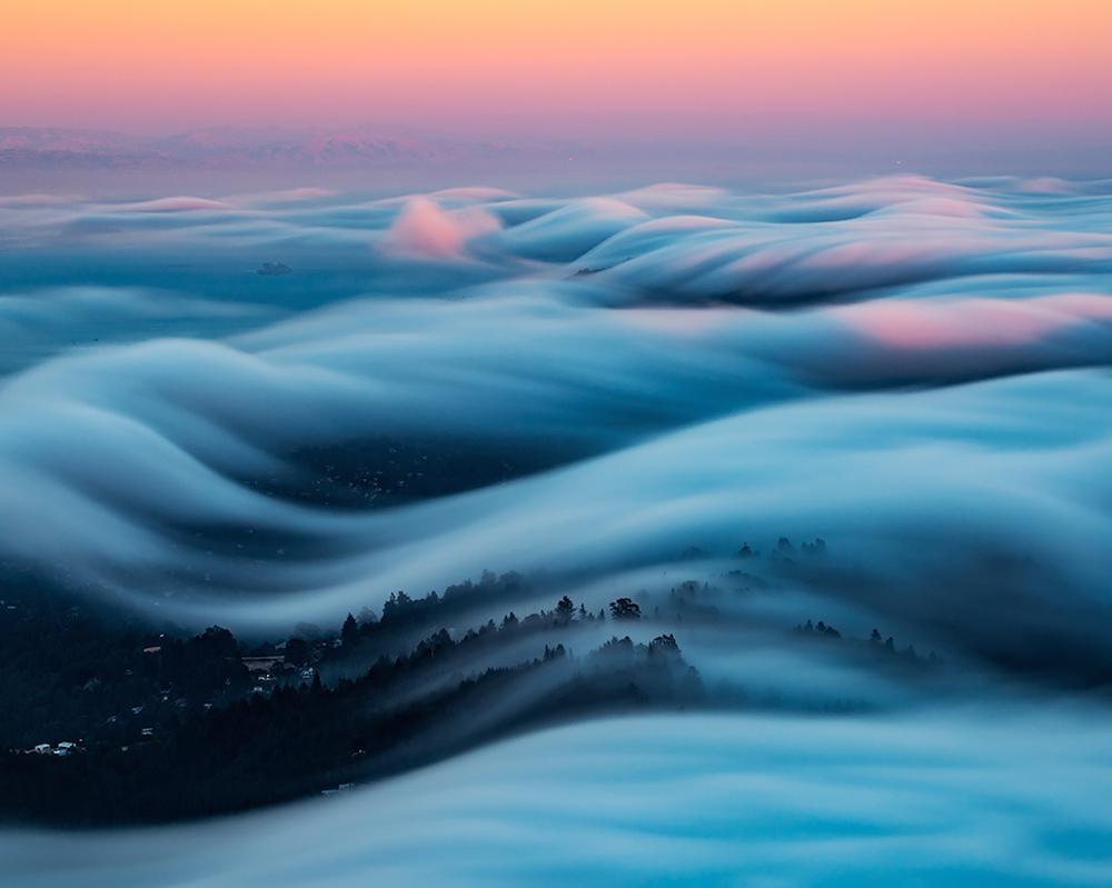 Rolling Images of San Francisco's Fog Against Neon Skies Shot by Nick Steinberg
