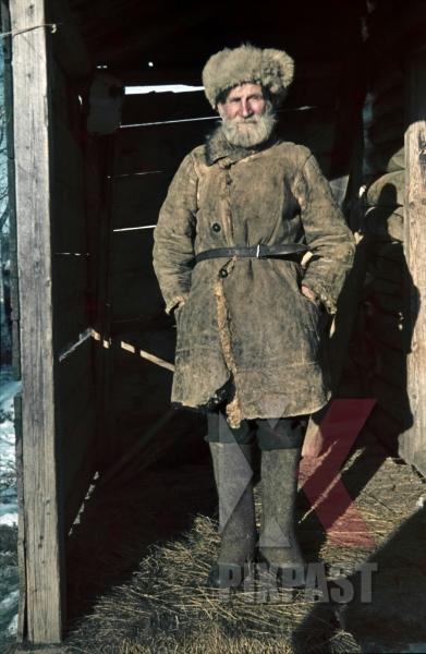 stock-photo-russian-peasant-farmer-portrait-winter-hat-jacket-cloths-fashion-russian-winter-snow-1943-boots-leather-belt-fur-hat-portrait-10020.jpg