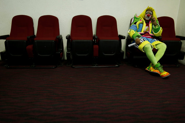 A clown rests during the XXI Convention of Clowns, at the Jimenez Rueda Theatre, in Mexico City, Mex
