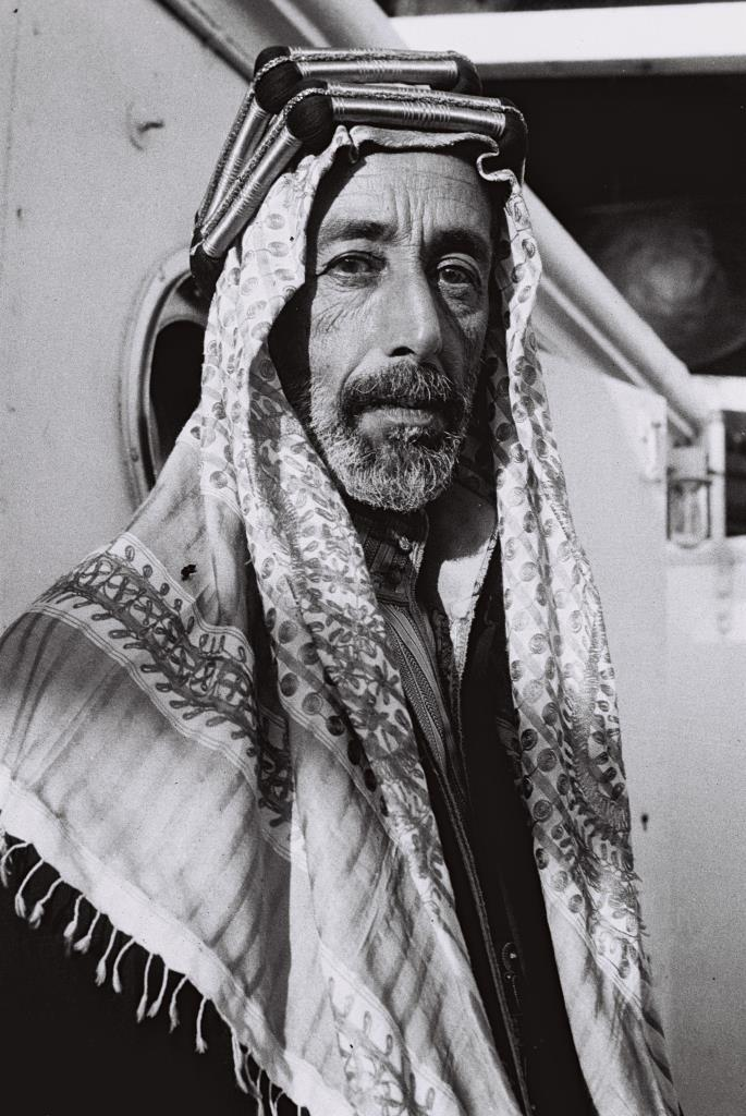 EXILED KING ALI OF HEJAZ PHOTOGRAPHED ABOARD A    SHIP ANCHORING OFF OF JAFFA, AFTER THE FUNERAL OF HIS       BROTHER KING FEISAL IN BAGDAD.äîìê òìé îçâ'àæ, öåìí òì ñéôåï äàåðéä, ìàçø ùäùúúó áäìååéú àçéå äîìê ôééñì       ááâãã, òéøà÷.