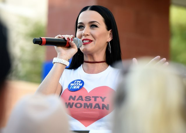 Singer Katy Perry speaks during a get out the early vote rally as she campaigns for Democratic presi