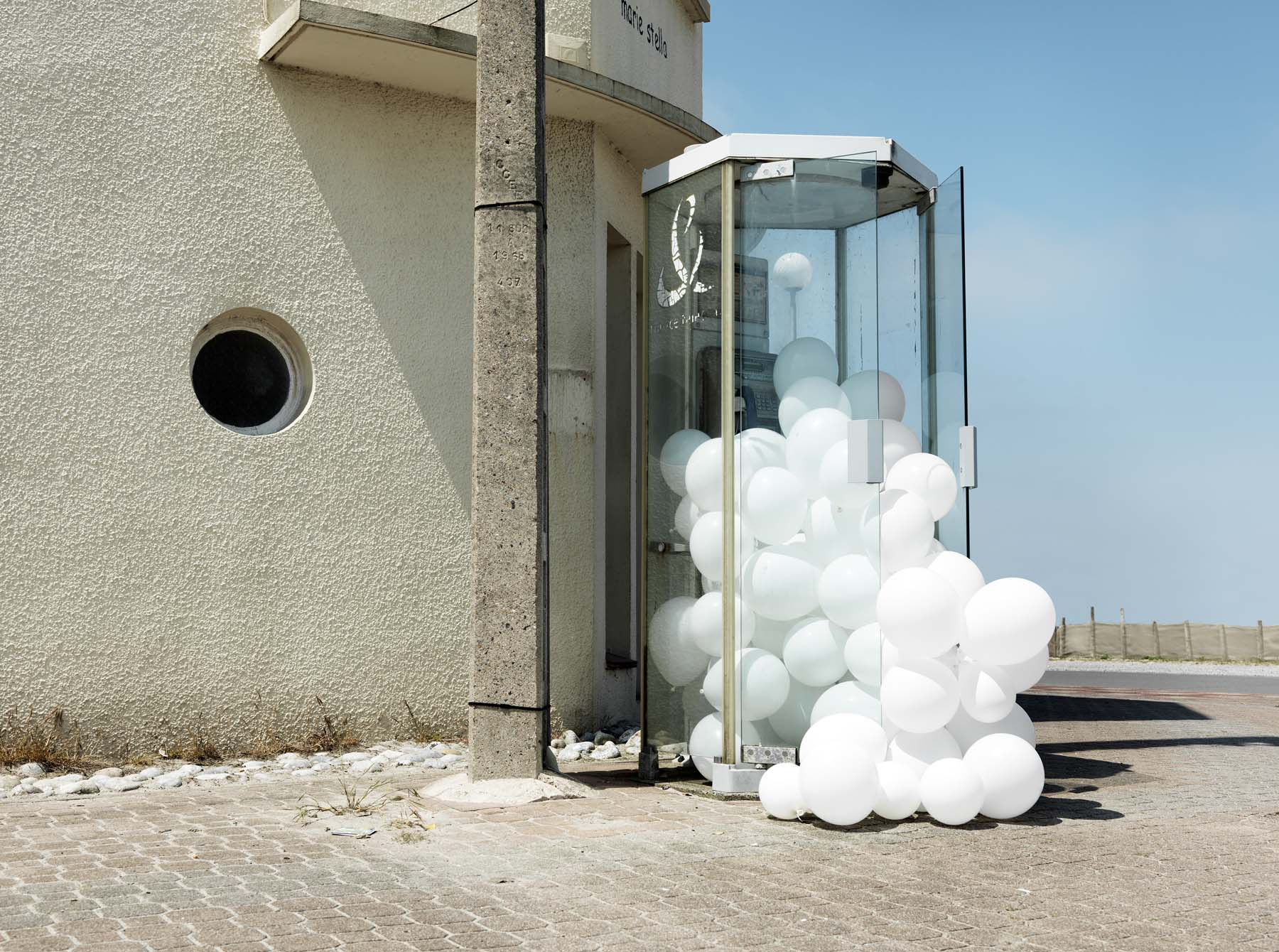 Clusters of White Balloons Photographed Invading Landscapes and Homes by Charles Petillon