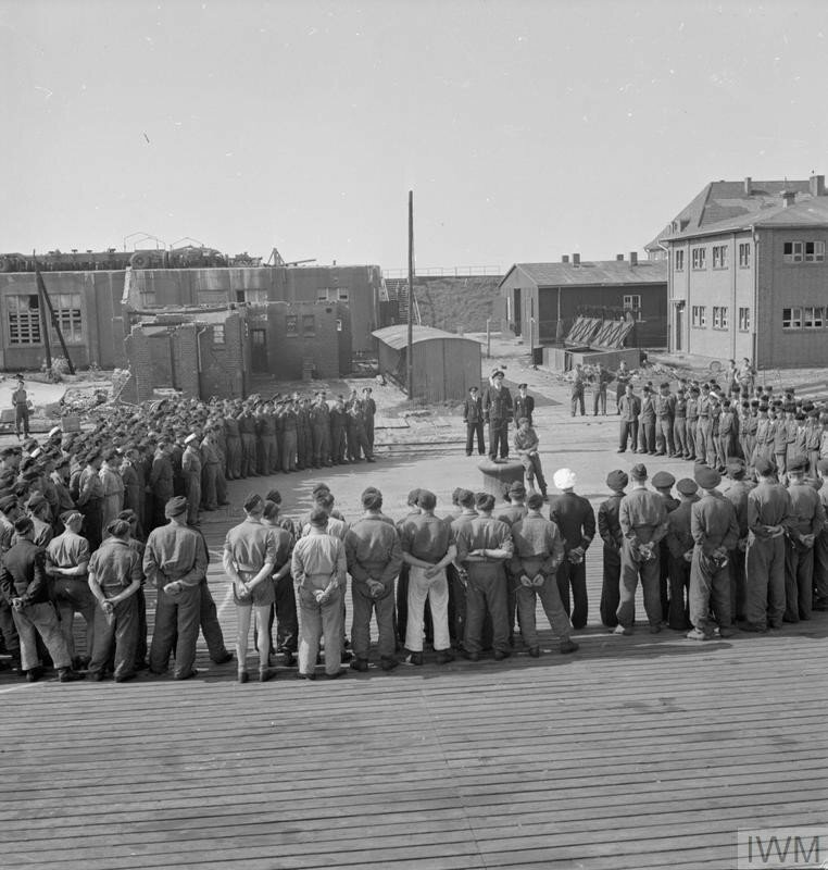 WITH THE NAVY AT WILHELMSHAVEN. 13 MAY 1945, THE GERMAN NAVAL BASE AT WILHELMSHAVEN AFTER THE FORMAL SURRENDER OF U-BOATS TO THE ROYAL NAVY.