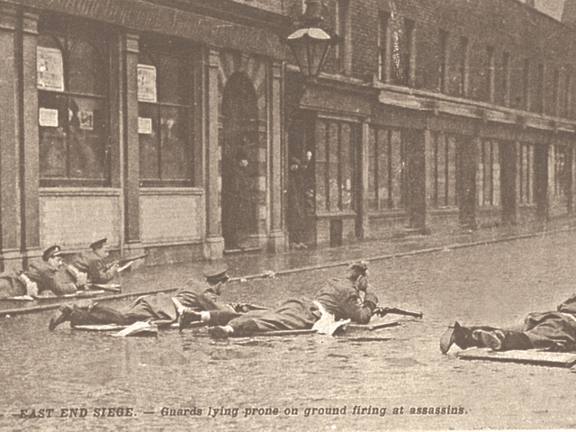 Siege of Sidney Street in January 1911 - Guards lying prone on ground firing at assassins