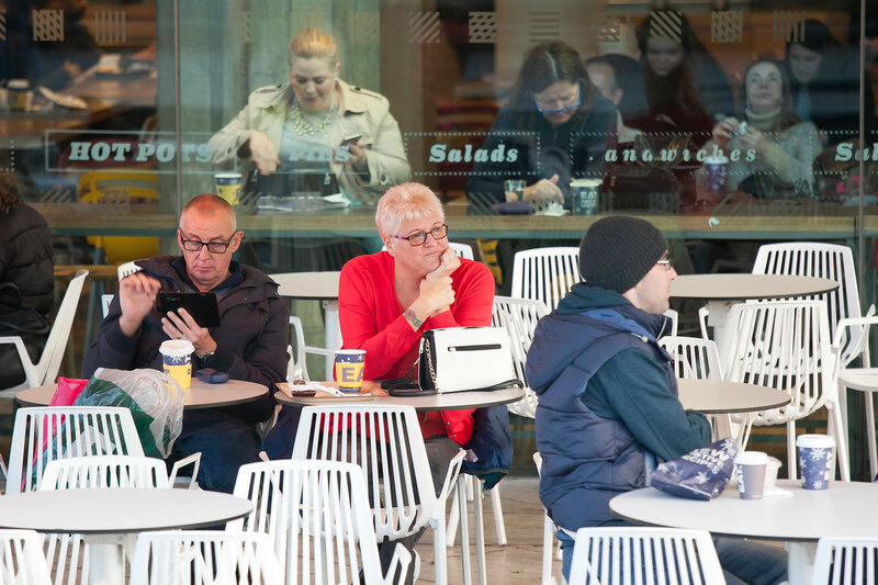 Cafe at the Thames embankment with people and tourists resting and refreshing