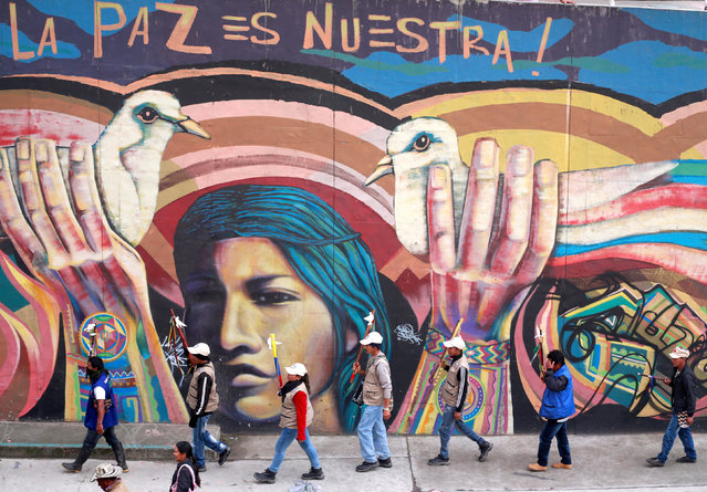 Indigenous Colombians rally for an imminent resolution to the nation's peace agreement during a marc